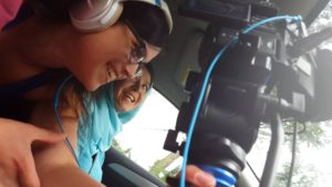 Rochelle Muzquiz and Eva Lorelle prepare to film a scene inside a car.
